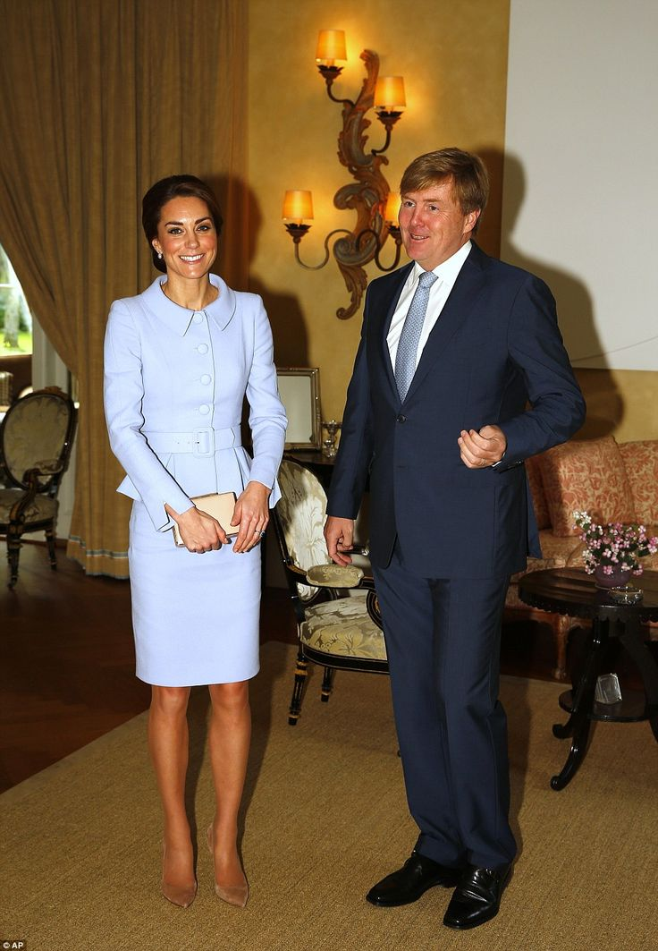The Duchess looked delighted to be meeting the Dutch monarch King Willem-Alexander and was showing no hint of nerves on her first official  overseas visit without William