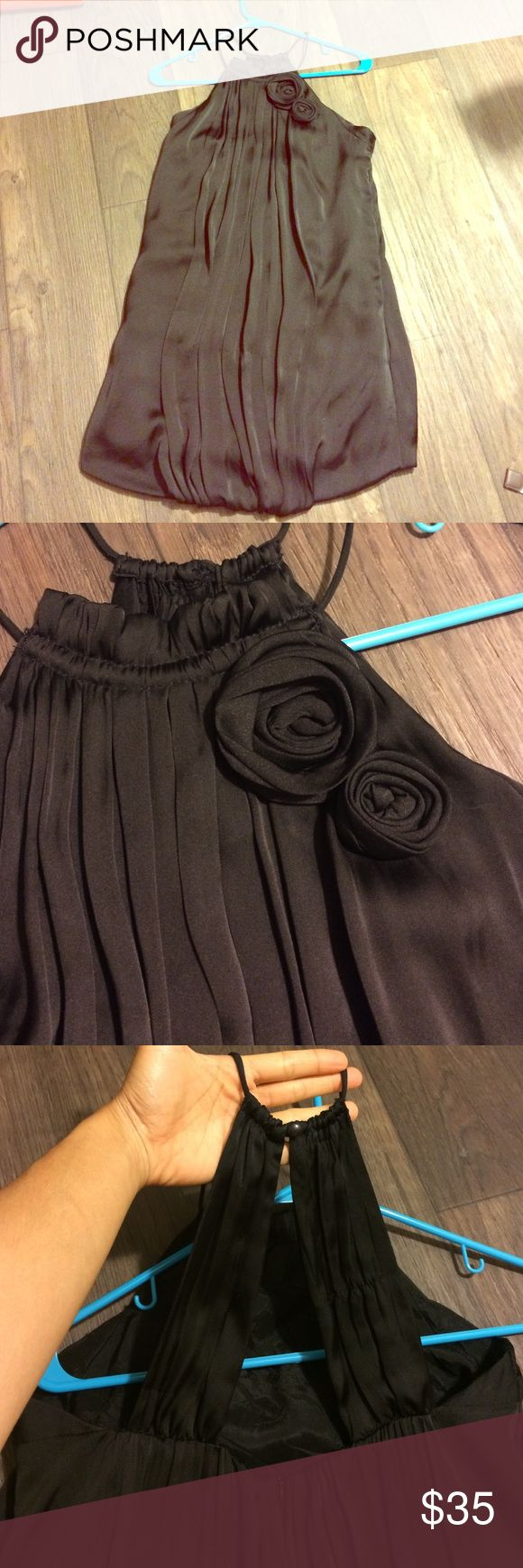 Zara tulip dress Super cute halter dress. Black satin material with small flower detail on the front and straps on the back. Fits S/M. Zara Dresses