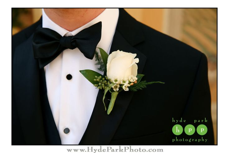 This classic white rose boutonniere looks great with Keith's dark blue tux! Photo by @hydeparkphoto. See more at http://www.hydeparkphoto.com/hotel-granduca-wedding-austin-texas/ ||  Austin weddings, Austin wedding photographers, Texas wedding photographers, wedding ideas, Austin wedding venues, Austin wedding venues outdoors, Hotel Granduca Austin, destination wedding photographers, Hyde Park Photography, Texas weddings, wedding boutonniere, white rose boutonniere, wedding photography…