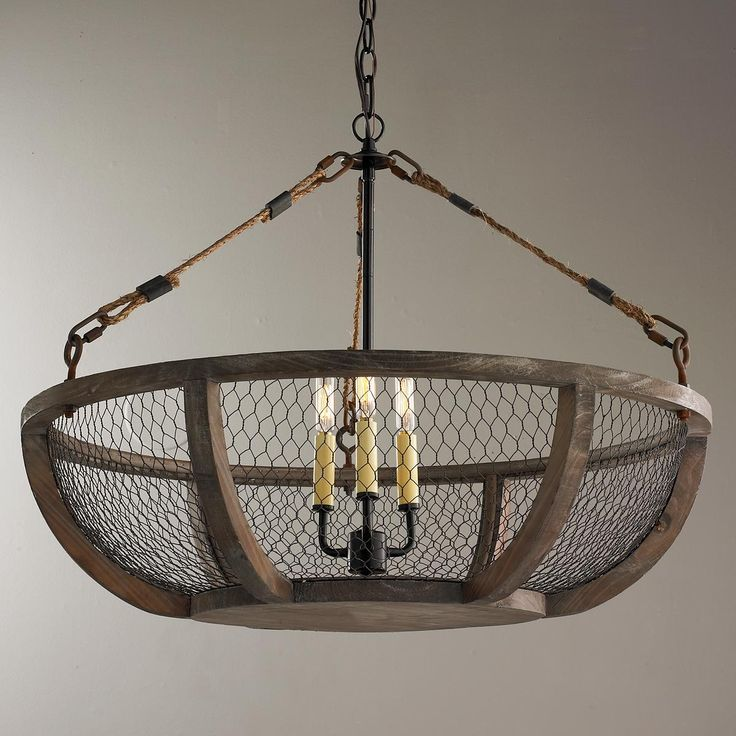 Chicken Wire Basket Chandelier Mesh wire wraps around a distressed wood frame for a country French style chandelier light perfect for low ceilings. This chandelier is a perfect match over an antique farm table or in a farm house kitchen. The wire basket resembles the ones used on farms for gathering eggs, vegetables or flowers. The bronze finish accents stay true to the style of the light.
