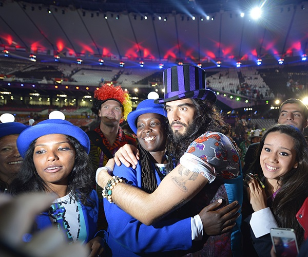 British artist Russell Brand poses with a performer during the closing ceremony of the 2012 London Olympic Games at the Olympic stadium in London on August 12, 2012. (Photo by Leon Neal/AFP/Getty Images)
