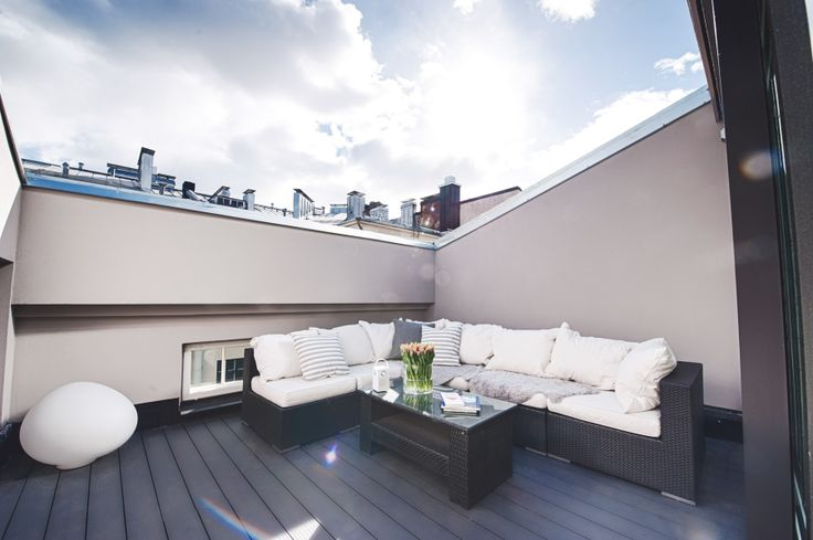 The penthouse with two bedrooms. The terrace. The stunning Helsinki sky!