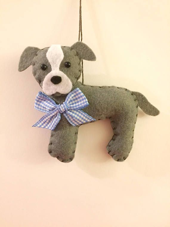 This is a felt Pit Bull ornament. This ornament makes a great gift for someone who loves Pit Bulls. He is designed and handmade by me! He is 4 inches tall and lightly stuffed. Find more cute felt ornaments here