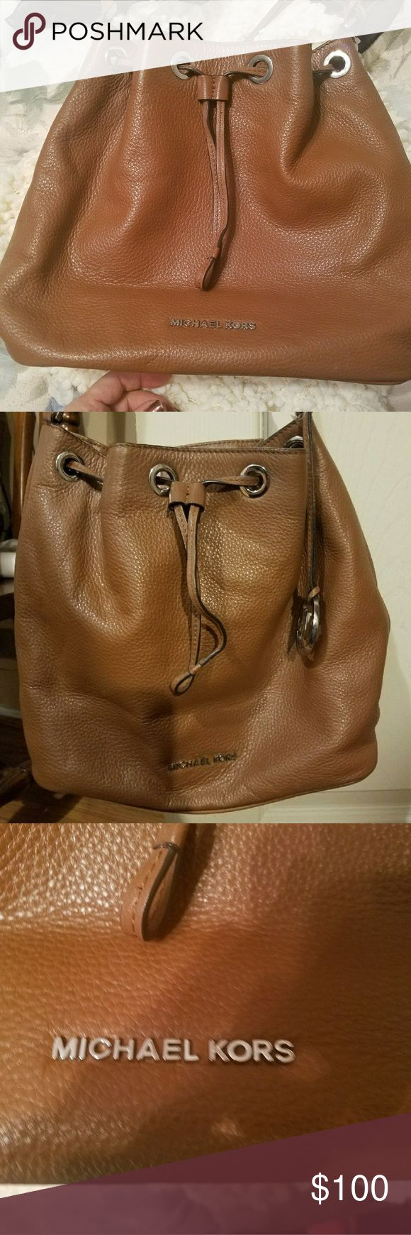 CLEARANCE!! Michael Kors brown leather handbag Michael Kors beautiful brown leather handbag gently used. Has a few small marks inside. 14 in across, 10.5 ht. Michael Kors Bags Shoulder Bags
