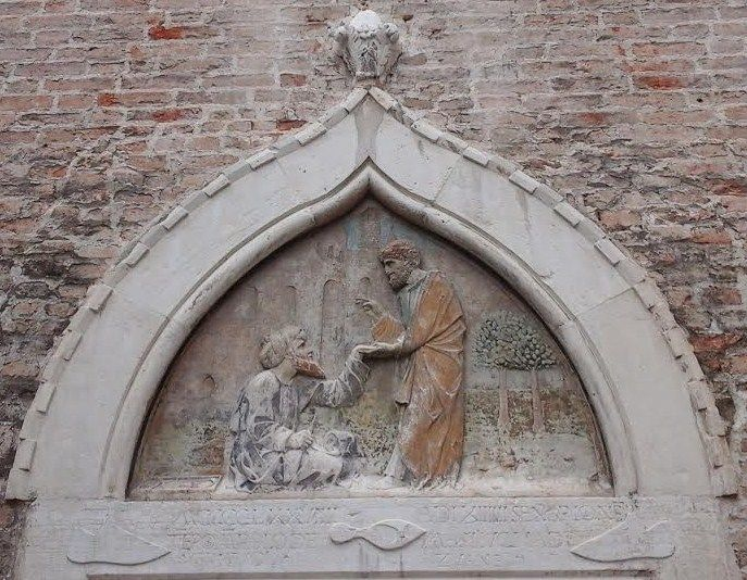 The bas relief on the main portal of the shoemakers' guild in Saint Toma's square