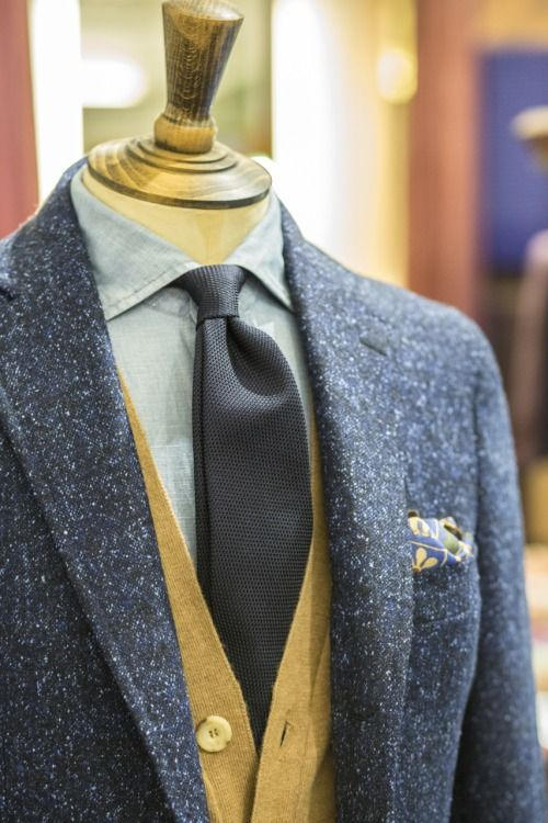 Drake's Blue Donegal Jacket in Wool and Silk, Navy Small Weave Grenadine, Cleeve of London Chambray Shirt, Sleeveless Camel Hair Cardigan and Elephant Print Wool Silk Pocket Square. All available from No.3 Clifford Street or our Online Shop.