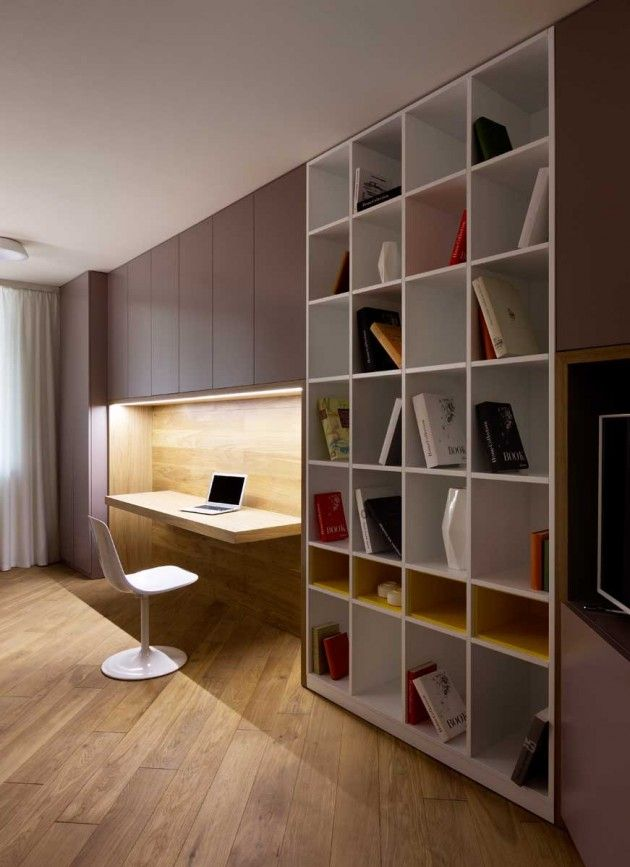 Simple bookshelf. Ambient lighting. Wooden flooring. Exquisite setup.