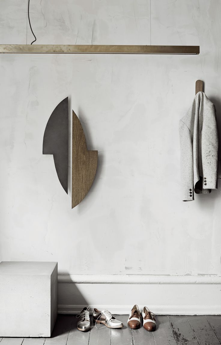 Entrance area inspiration. Gemini wall sculptures along with Anour lamp to complement your best coat. An exclusive cool, however soft, look in balanced colours. Zinc and dark oiled oak.