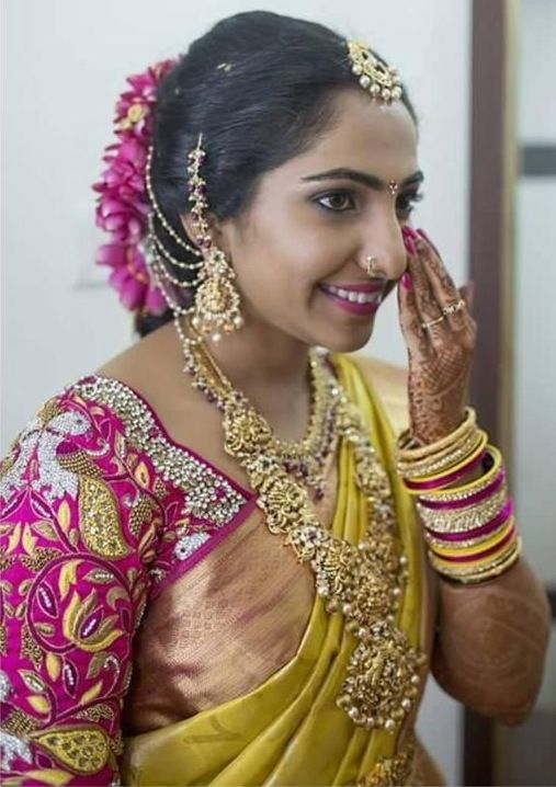 South Indian bride. Diamond Indian bridal jewelry. Jhumkis.Yellow kanchipuram sari with embroidered pink contrast blouse.Braid with fresh jasmine flowers. Tamil bride. Telugu bride. Kannada bride. Hindu bride. Malayalee bride.Kerala bride.South Indian wedding
