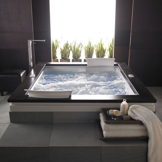 """The impressive Fuzion Dual Whirlpool Bathtub incorporates state-of-the-art overflow technology for a visually pleasing full-fill look. Fuzion tubs are compatible with the Fuzion wooden frame (Frame NOT included) High gloss acrylic. Tru-Level base. Slip resistant flooring. Equipment location: Right hand. Lighting system: Illumatherapy. Whisper quiet technology. LCD control. - Overall Length - End to End: 71.75""""- Overall Width - Side to Side: 59.75""""- Overall Depth - Top to Bottom: 24""""- Overall…"""