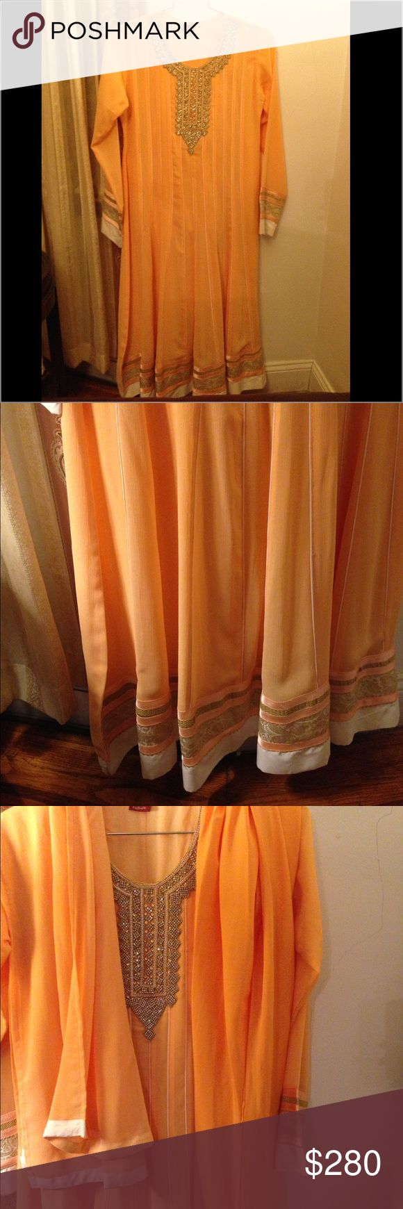 ☀️SALE☀️Indian Pakistani shalwar kameez dress Pakistani Indian party wedding occasion dress. Color is a light true peach. Looks a little orange in photos (last photo is closer to true color) Elegant and beautiful piece. Bollywood  Worn once. Practically new. Beautiful peach dress with detailed sleeves and design and bottom. Stone work on chest. Bought for $380. Roughly size L to XL.  3rd photo left dupatta/scarf tight pants/chruidar   Measurement can be taken upon request. Please specify…