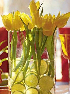 A  citrus sensation of yellow tulips and sliced limes.Easy and simple centerpieces