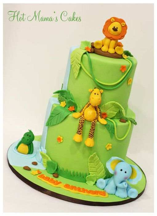 Jungle themed baby shower cake elephant, giraffe, crocodile, lion... needs a monkey
