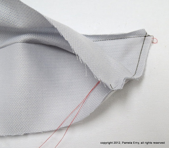 This is brilliant. Turning a perfect shirt collar point with a thread loop. Pam Erny is a shirtmaking god.