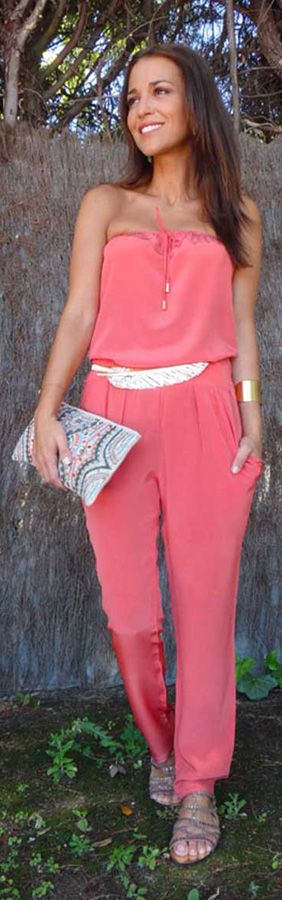coral jumpsuit with some golden touches