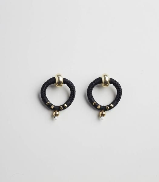 Inspired by ancient Berber sun signs and the Daughter of Ra who was regarded in ancient Egyptian mythology as 'The Lioness,' these earrings convey the fierce, r
