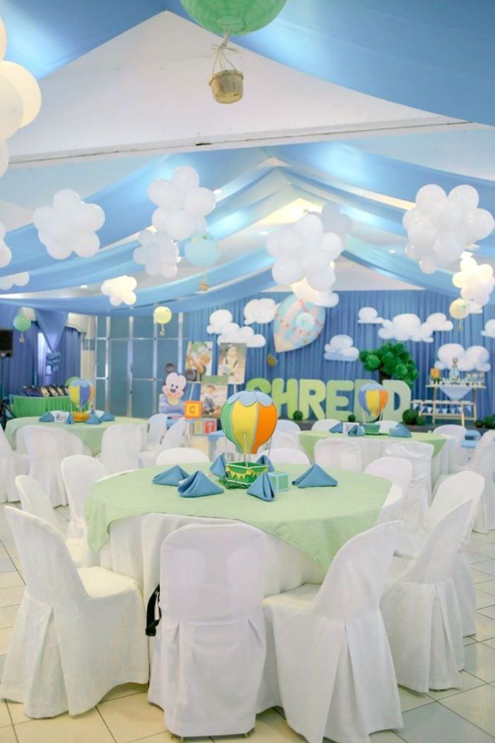 Party tables and gorgeous balloon clouds from Mickey Mouse Hot Air Balloon Birthday Party at Kara's Party Ideas. See all the inspiration at karaspartyideas.com!