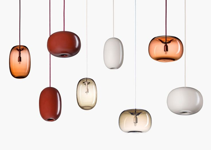 Pebble-shaped pendant lights by Joel Karlsson made from spun steel and blown glass
