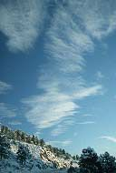 """Cirrus clouds are thin, wispy clouds blown by high winds into long streamers. They are considered """"high clouds"""" forming above 6000 m (20,000 ft). Cirrus clouds usually move across the sky from west to east. They generally mean fair to pleasant weather."""