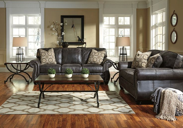 <strong>Breville Charcoal Sofa Set</strong>Plush comfort and a versatile earth tone palette make the Breville sofa series a stylishly practical choice. The dusky charcoal color adds a timeless charm complete with nail head trim. The bun feet in a dark faux wood finish add elegance and flair. If classic beauty is what you seek, the Breville is for your living space.<em>*The Breville charcoal sofa set consists of a sofa and a love seat.</em>