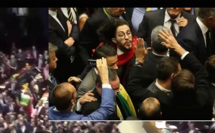 Brazilian Congressman Jean Wyllys spits toward Representative Jair Bolsonaro during last night's Brazilian congressional vote in favor of impeaching President Dilma Rousseff.