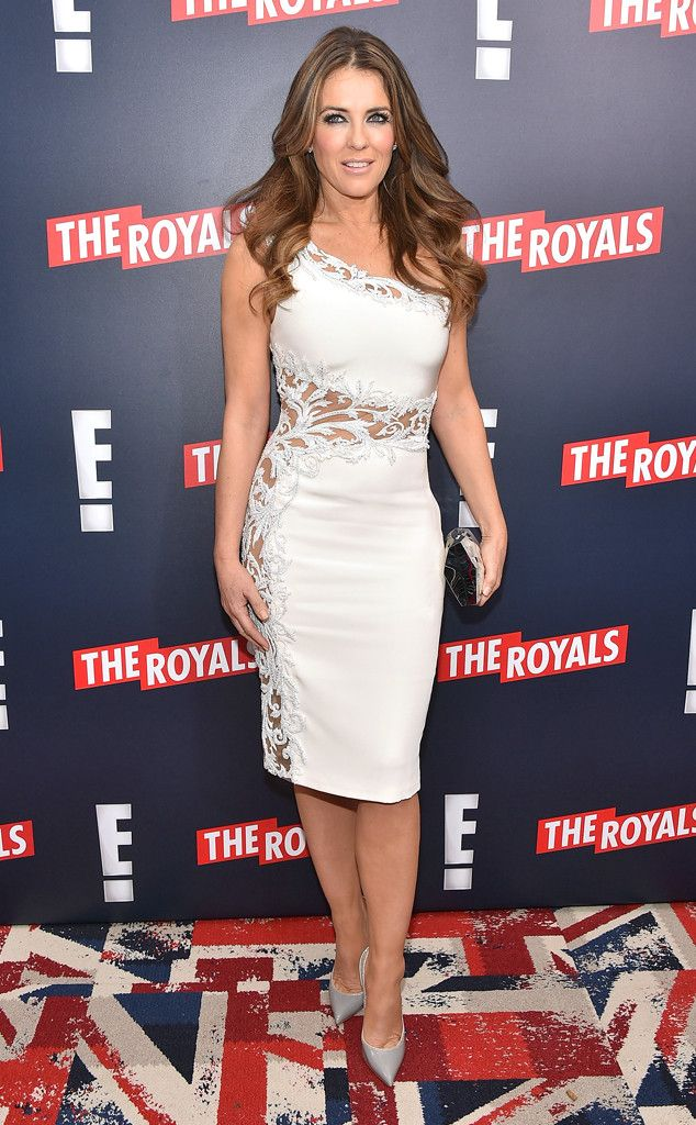 Elizabeth Hurley from The Best of the Red Carpet  The Royals star absolutely sizzles in a white one-shoulder Lorena Sarbu mini with sheer overlay at her show's New York City premiere.