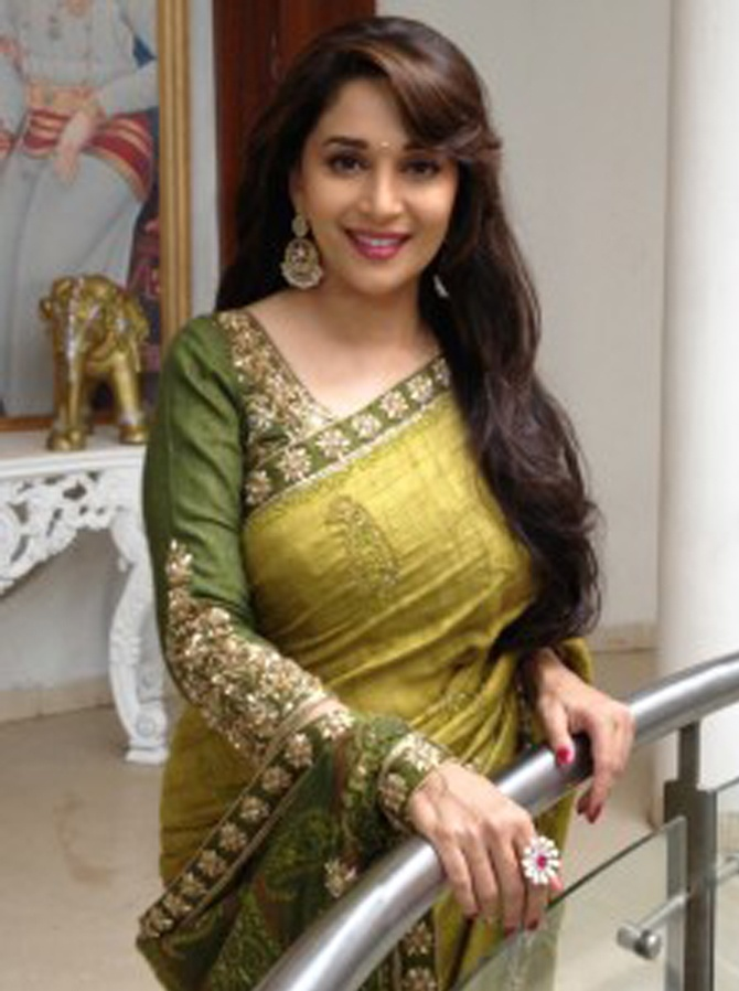 Madhuri Dixit looks magnificent in saree. Creating redefining trend of embroidered sarees.