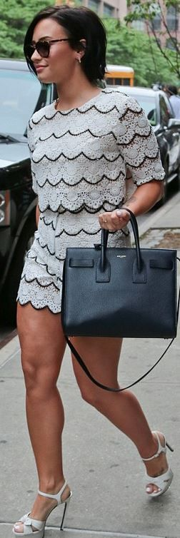 Who made  Demi Lovato's black scallop shorts, white tee, platform bow sandals, and black tote handbag?
