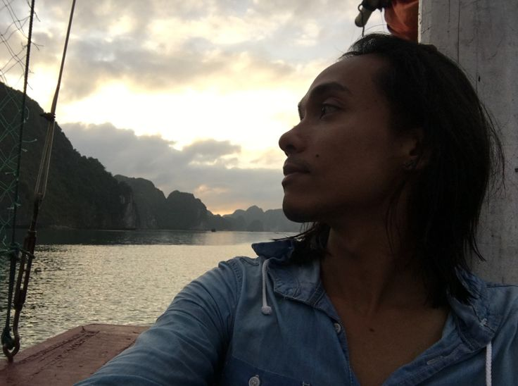 Watching the sunset while on a sailing junk in Cat Ba archipelago in Northern Vietnam.