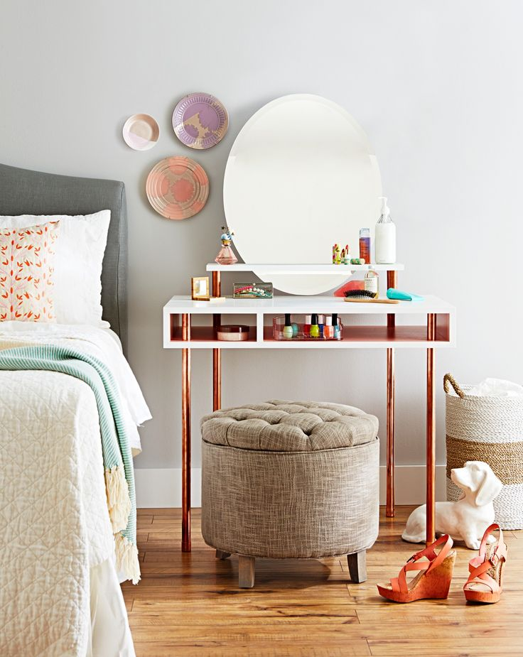 This DIY dressing table with a floating shelf and mirror uses copper pipes for the legs. Build your own vanity table for about $179.