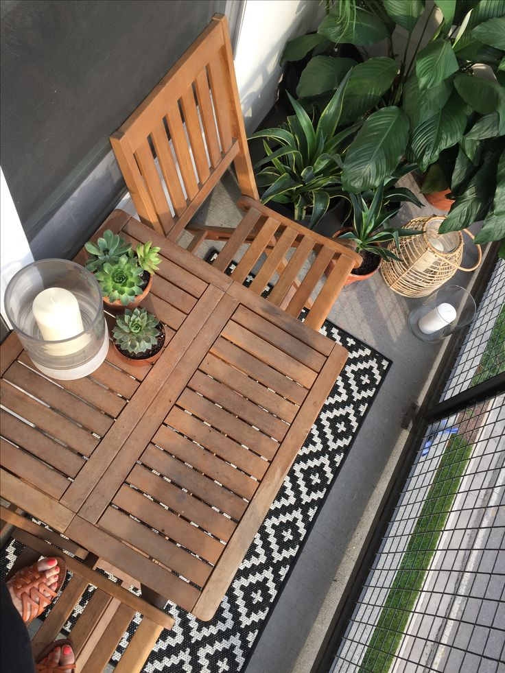 Small balcony decor ideas. Small garden. Target and World Market furniture. Succulents and candles.