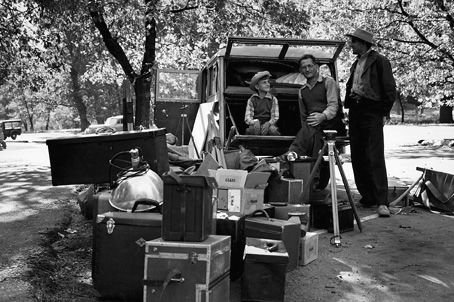 Ansel Adams, Cedric Wright, and Adams' son Michael packing for a trip in 1941 (Photo by Virginia Adams from the book The Grand Canyon and the Southwest by Ansel Adams)