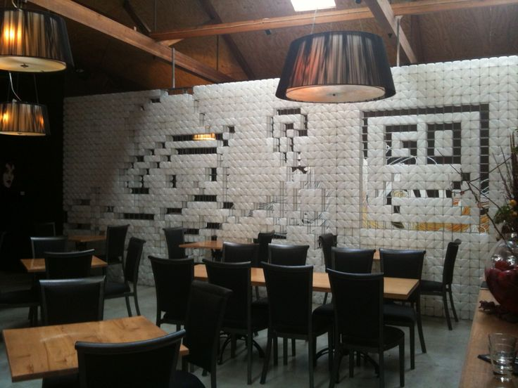 A wall out of milk cartons!  Thanks West End Pumphouse in Hobart for such a great idea. I bet if you filled the cartons with water you could use it as a Trombe Wall heat store.