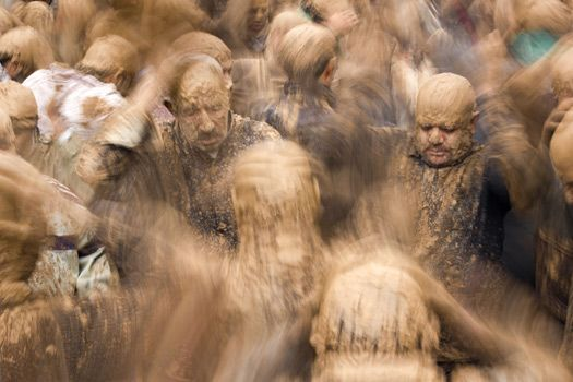 © Photo and caption by Guido Dingemans / National Geographic Traveler Photo Contest. Iranian shi'a muslim men, in trance and covered in mud, mourning during the Day of Ashura, on which shi'a muslims commemorate the martyrdom of Husayn, grandson of Muhammad, and third shi'a imam. The mud is an important part of the local mourning ritual. Shot in the town of Bijar, Iran.