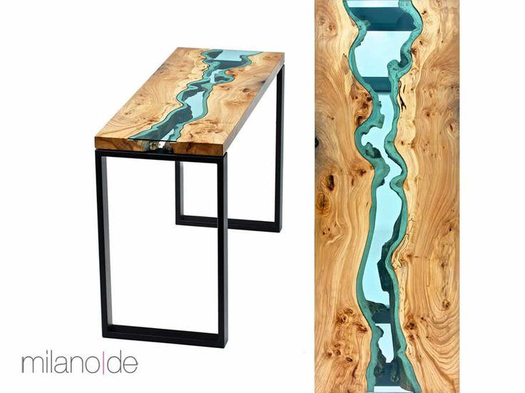 Κονσόλα River με καπάκι από μασίφ ξύλο δρυός ή καρυδιάς, με ειδικά επεξεργασμένο κρύσταλλο στο κέντρο του και με μεταλλική βάση. Ο σχεδιασμός του επίπλου το καθιστά ξεχωριστό καθώς το κάθε κομμάτι είναι μοναδικό.  https://www.milanode.gr/product/gr/2382/%CE%BA%CE%BF%CE%BD%CF%83%CF%8C%CE%BB%CE%B1_river.html