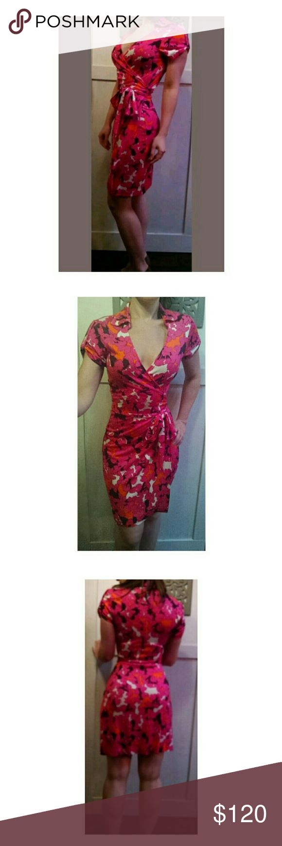 "DVF Pink Floral Deep V Cap Sleeve Wrap Dress Gorgeous DVF ""Jilda Two"" wrap dress in a bright pink floral print. Features a Deep V, tie enclosure, collared neckline and cap sleeves. The cut of DVF wrap dresses are flirty, flattering and fun. You will love this!!?  Tagged as size 10. This dress seems to run a little small. A US 6-10 would work here. Given the style of the dress, the below measurements are variable (plus or minus) by a couple inches.  Measurements taken laying flat: Bust: 17""…"
