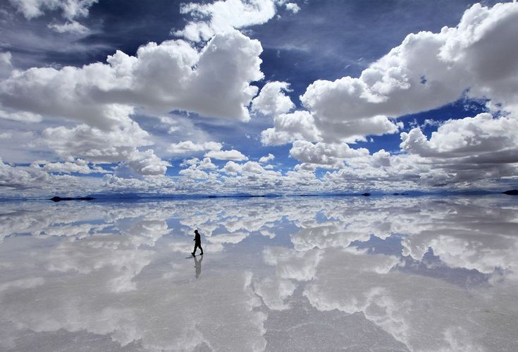 Salar de Uyuni, Bolivia the world's largest salt flat (10,582 sq. km.) also boasts the world's largest natural mirror; seasonal rain falls on the salt flat deposits to create a stunning reflective landscape. Fast becoming a popular tourist destination, Salar de Uyuni gives travelers a chance to walk on water…or in the clouds.