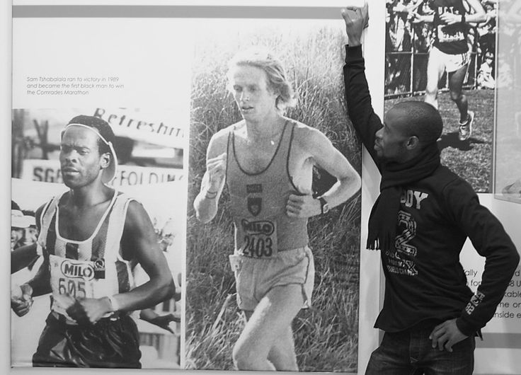 The face of the #Comrades2017 campaign, Velani Sosibo, paying homage to Comrades legends at the newly revamped Comrades Marathon Museum