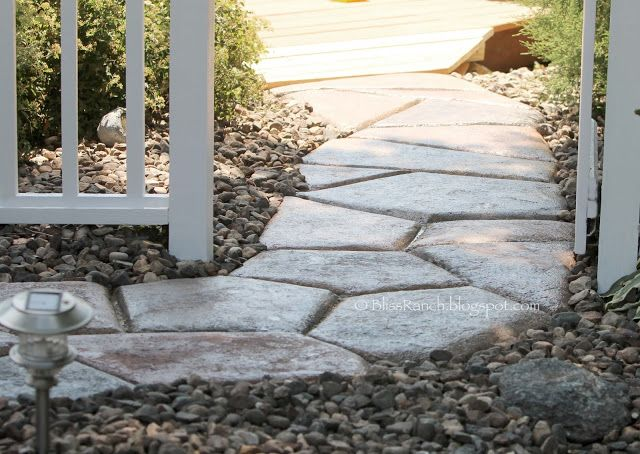 Concrete Stone Walkway...no forms, just free form concrete project. I like this!