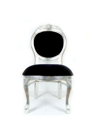 Silla (dos unidades). Fabricada en madera, color plata. Con asiento y respaldo tapizado de terciopelo color negro.  Es el mueble perfecto para completar el salón, hueco de la escalera, despacho...  Envío gratis en 24h.