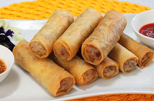 Cambodian Egg Rolls | Egg rolls have been a big part of my life. It was the first thing I ever learned to make. I have become a master at rolling them. From the age of seven, I have been sitting next to my mom, aunts and grandmother peeling egg roll sheets and watching them roll cute little crunchy packets. I loved them and I couldn't get enough. | From: bemindfulbehuman.com