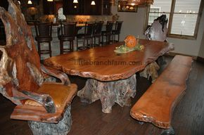 natural wood dining tables with burl wood chairs crafted from recovered old growth redwood burl wood slabs with root bases creating unique natural wood furniture with its warm organic live edge