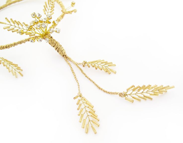 Vintage glam! Close up - a circlet of gold diamantes and gold beaded leaf embellishments. Find your perfect wedding flowers at http://www.loveflowers.com.au