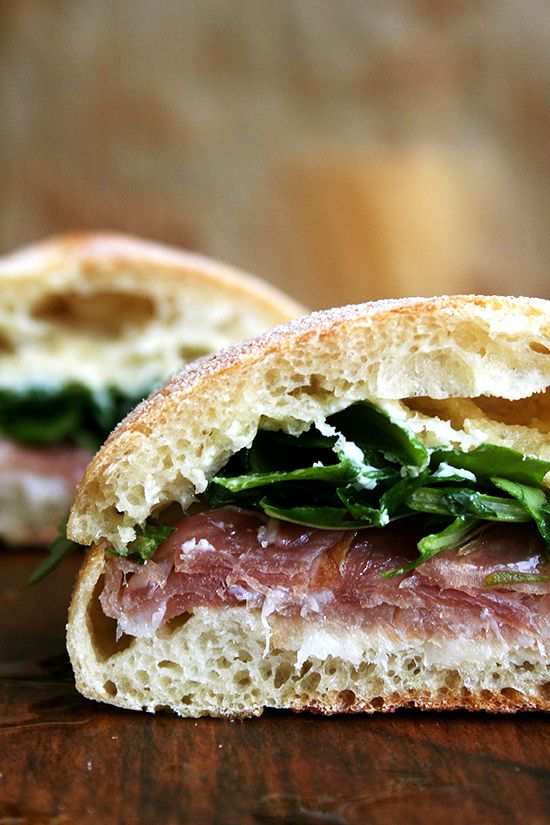 "For Gabrielle Hamilton, the success of this prosciutto and arugula sandwich relies on a delicate balance, ""the perfection of three fats together — butter, olive oil, and the white fat from prosciutto or lardo."" Served on (faux) ciabatta bread, it's delicious."