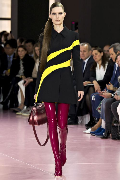 Dior flashed back to the 80s with psychedelic motifs such as abstract animal prints, fluorescent lightning bolts and miniskirts with vinyl thigh high boots featuring among the stand-out looks of the season.