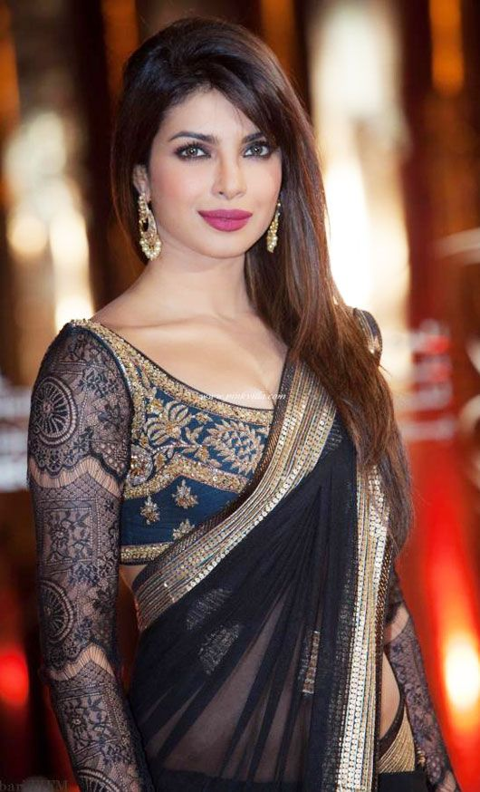Priyanka Chopra at the 12th International Marrakech Film Festival...  I don't agree with the blogger on anything, but that she looks absolutely gorgeous in this stunning Sari.