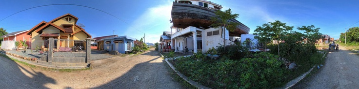 Banda Aceh, Indonesia. During the tsunami of 26th December 2004, a fishing boat was thrown by the wave, from the fishing port nearby, on to the roof of a house.