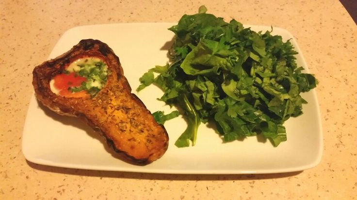 Baked butternut  squash  with eggs and green salad