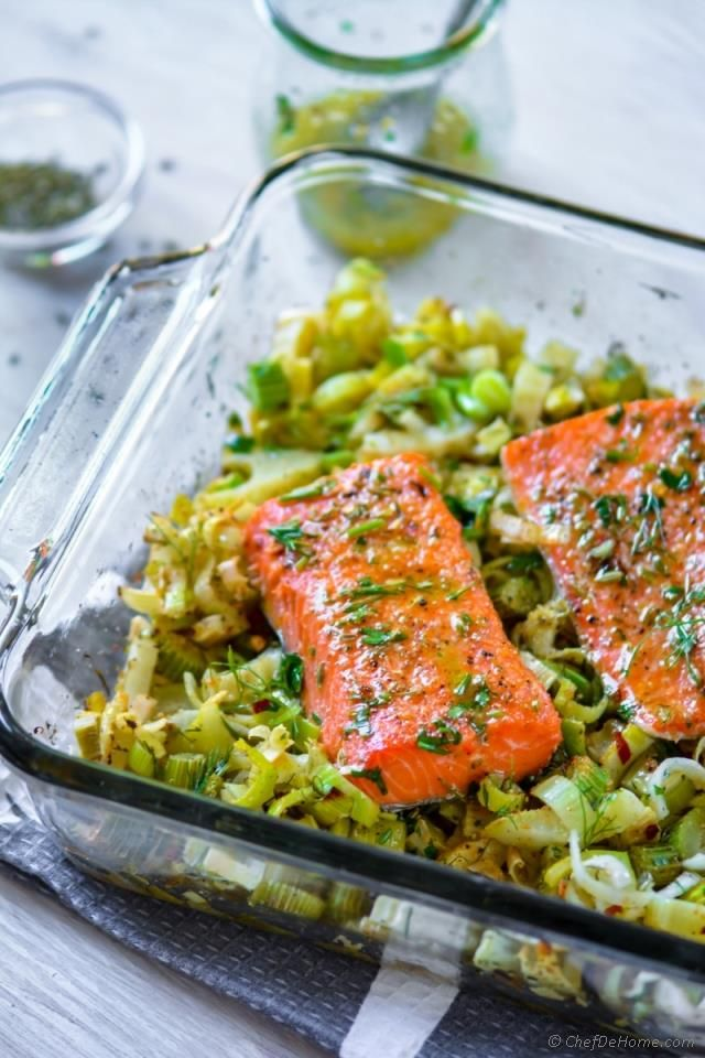 Baked Lemon Salmon with fennel, a flaky perfectly baked salmon , cooked with aromatics like fennel seeds, sweet fresh fennel, leeks, and fresh lemon-herb dressing! For another layer of flavor, I co...