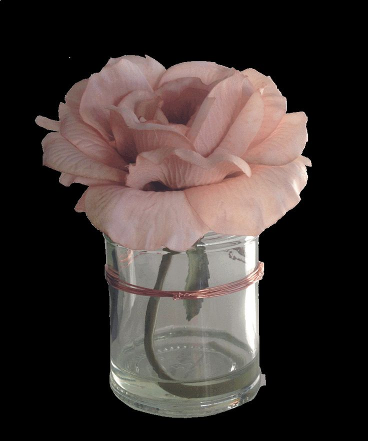 Blush Rose Arrangement in Glass Jar Vase with Copper Detailing. Paper Whites stunningly realistic artificial floral arrangements are designed and hand made in the UK. Produced to depict a fresh start and evoke memories to lift the spirits. All arrangements come with the beautiful vases you see in the picture. This is a beautiful blush rose in a glass jar with copper wire detail. Sits alongside our Copper Heart Jug & Cream Rose Arrangement with Copper Detail wonderfully. Height: 16cm